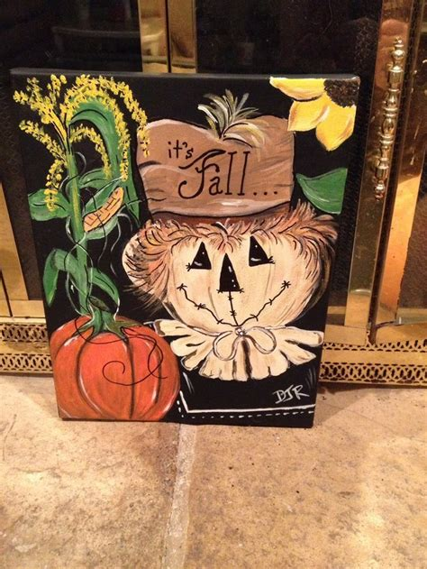 Painted fall canvas with scarecrow and pumpkin