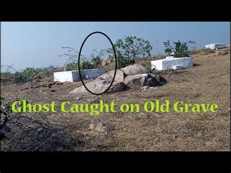Ghost caught sitting on old grave   Scary ghost found