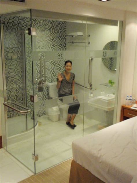 our quirky hotel room complete with bathroom with glass
